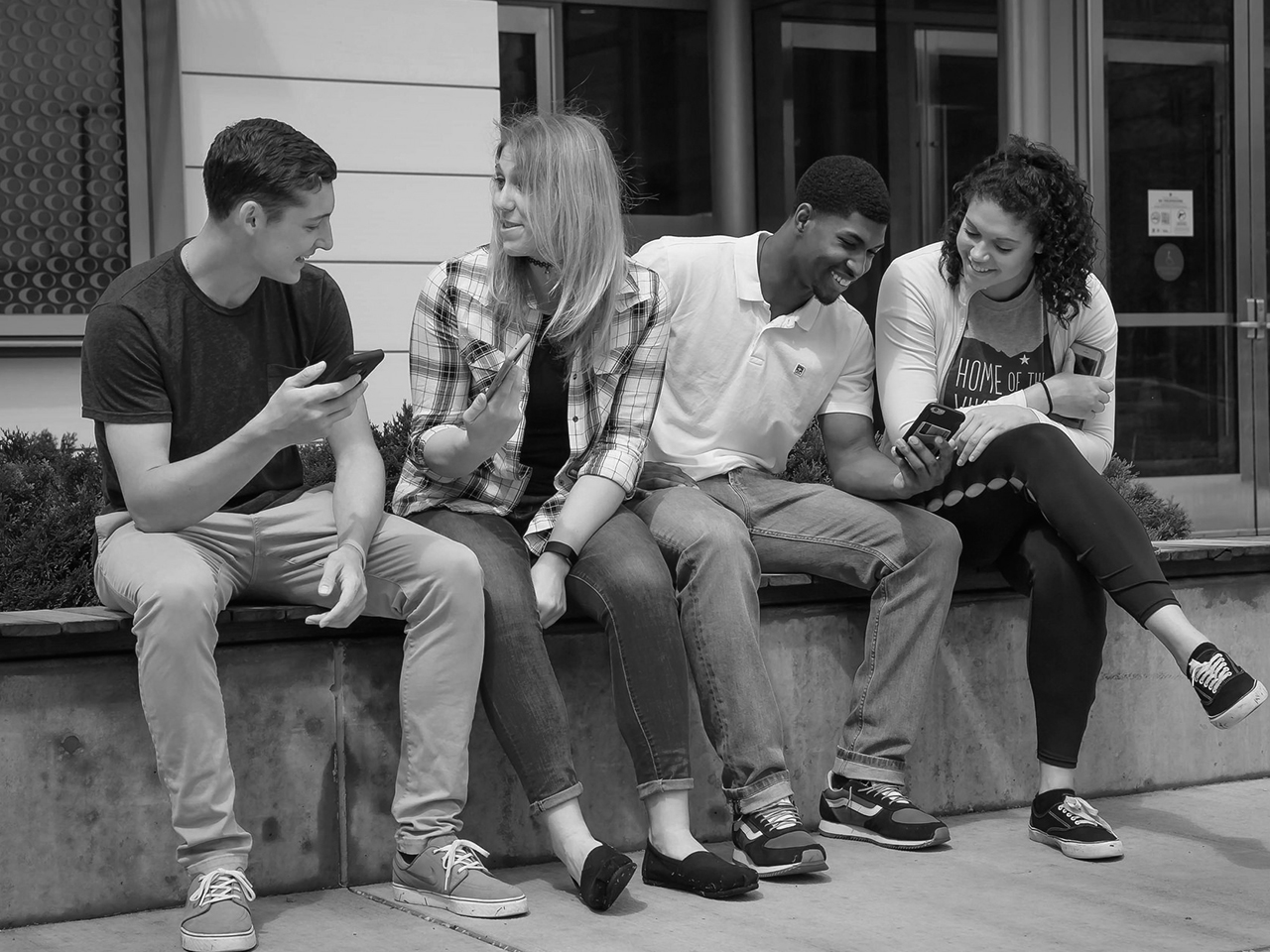 Photo of group of CSU students sitting in the plaza