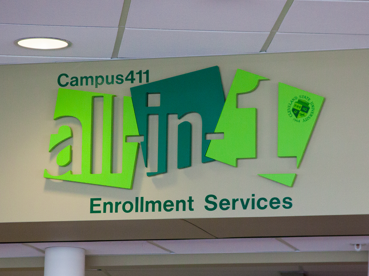 Photo of the sign for the offices of enrollment services at CSU