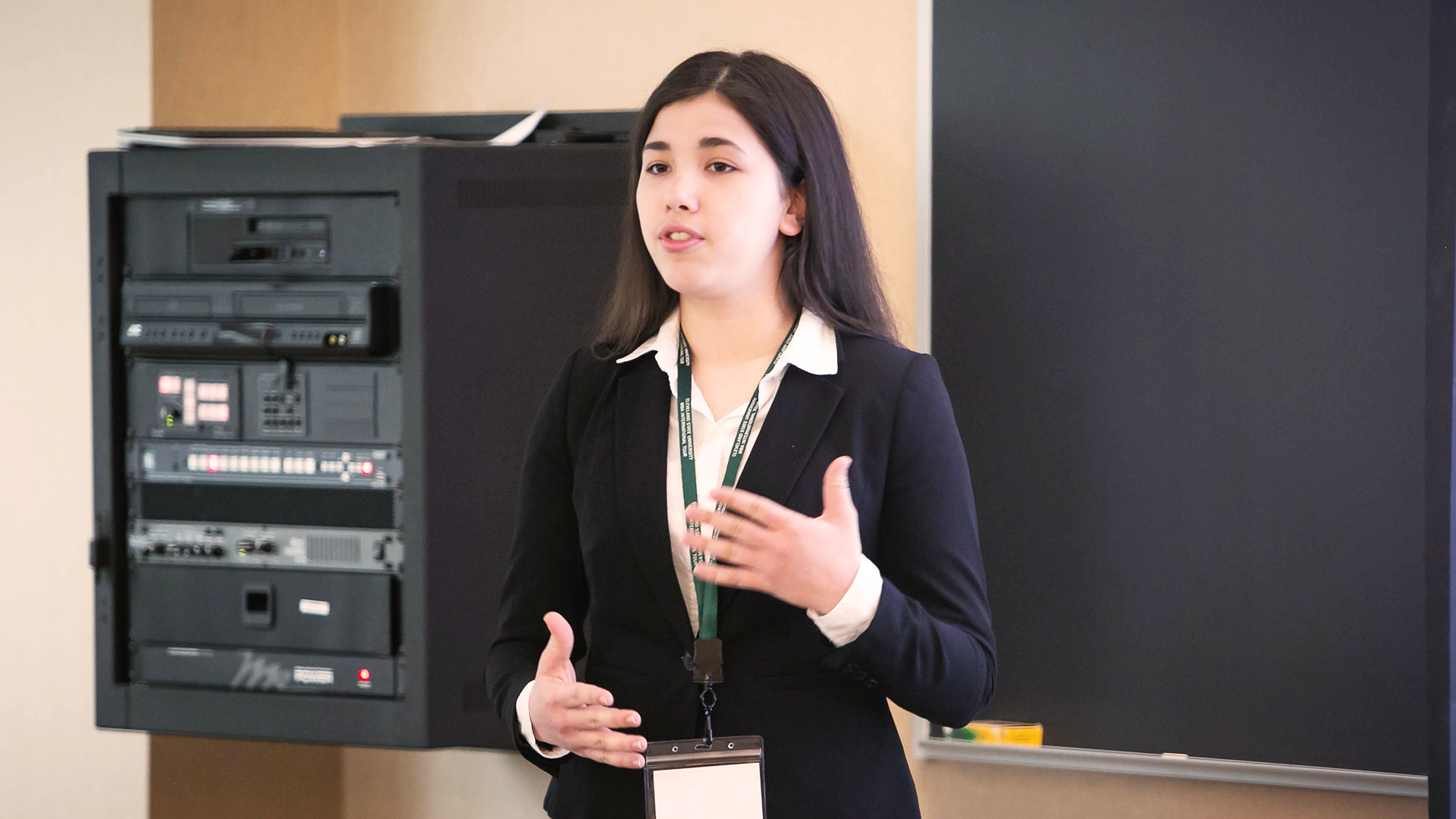 Photo of a CSU student presenting to a client