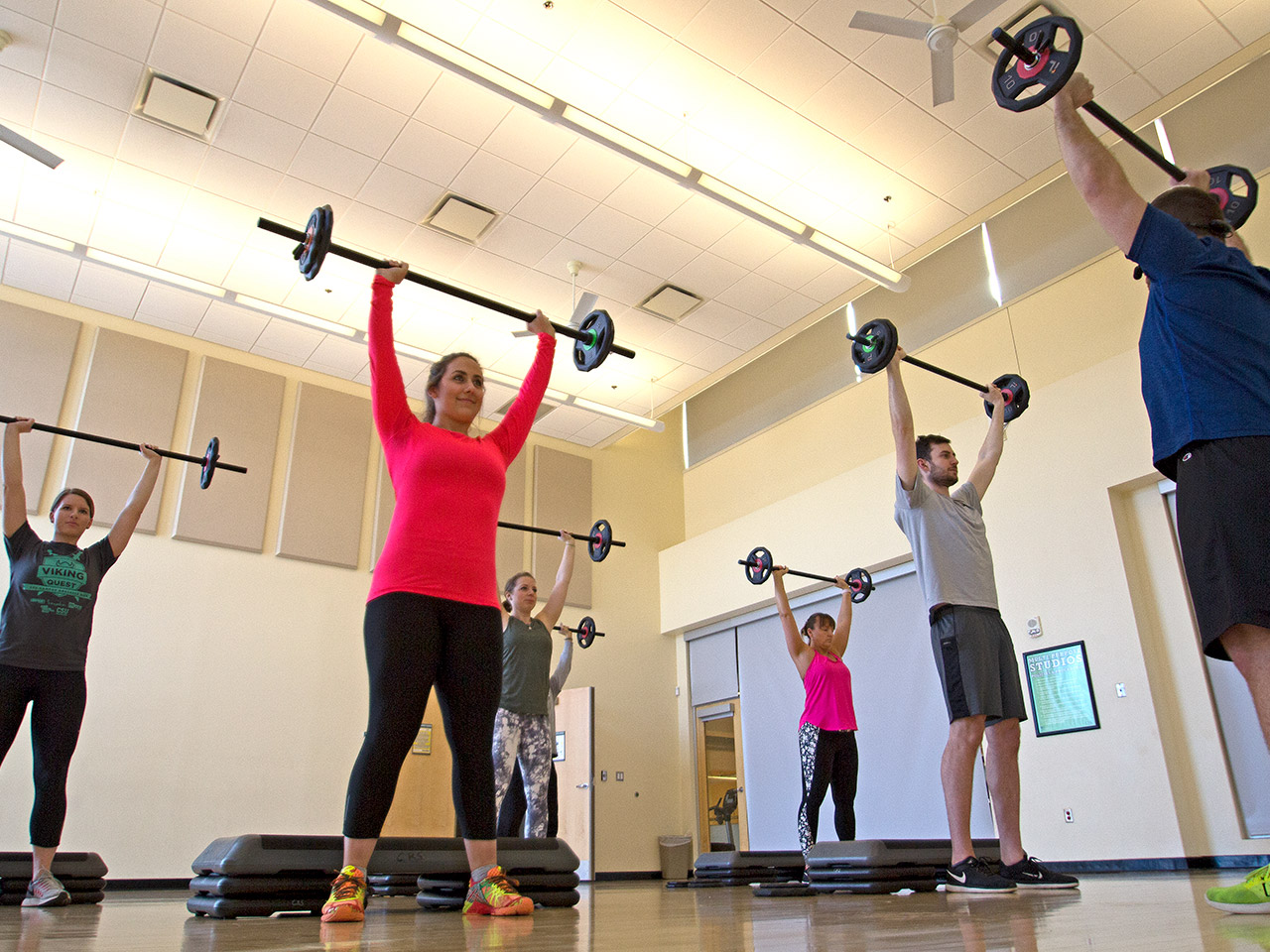 Photo of students lifting weights at the Rec Center